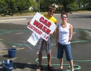 Christina, all grown up, helping at a fundraising car wash.