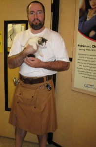 Brian and Milton, the kitten, in the adoption room
