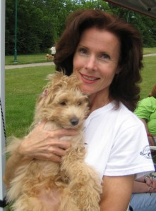 Our good friend, Susan, and her puppy mill pup, Jimmy, who lost his leg due to the horrific conditions in the cage he was in.