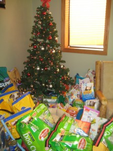 It looked like Christmas morning with all the goodies piled around the tree--only these were donations for pets in need!!